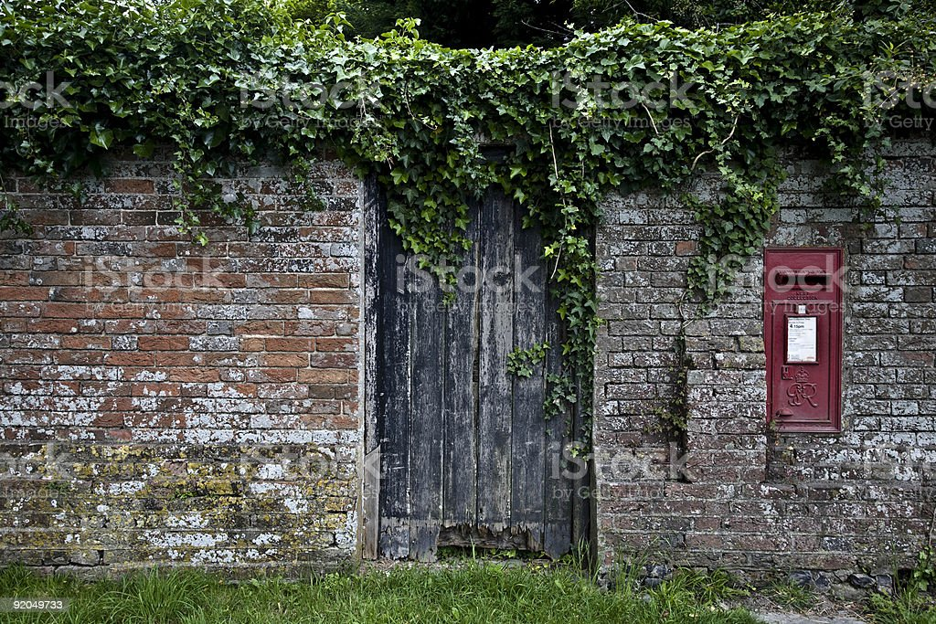 Old weathered door, brick wall and mailbox royalty-free stock photo