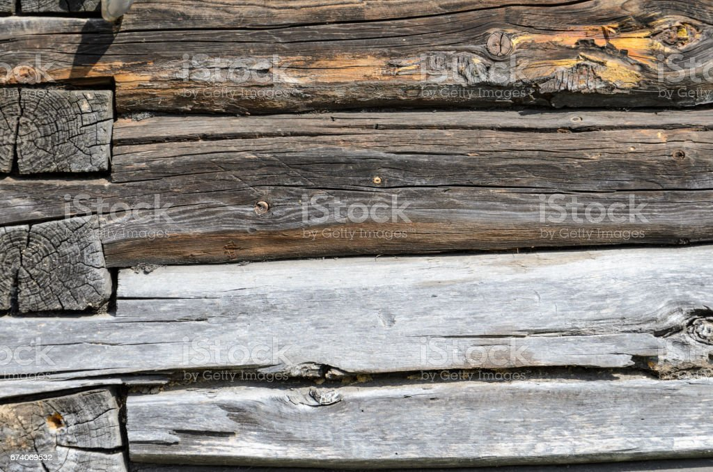 Old Weathered Natural Log Cabin Aged Wall Facade Fragment Texture. royalty-free stock photo