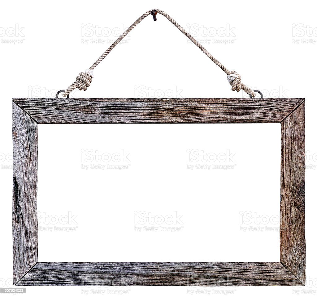 Old weathered natural wood frame hanging by rope. stock photo