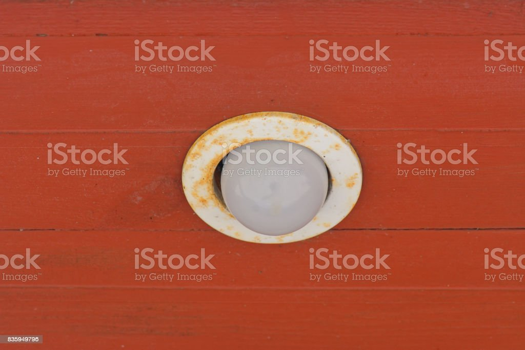 Old weathered recessed ceiling lamp stock photo