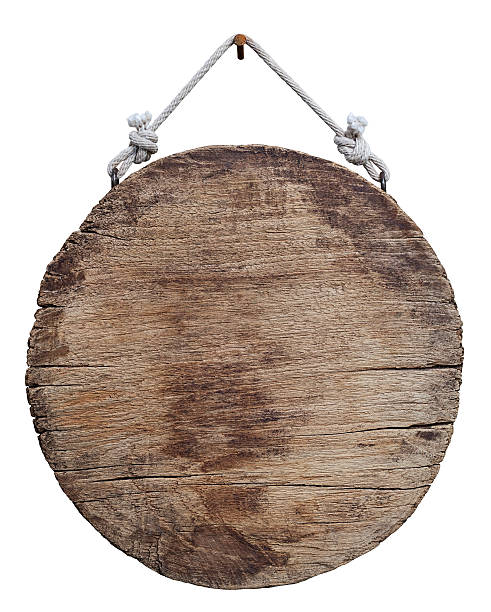 Old weathered round wood signboard. stock photo