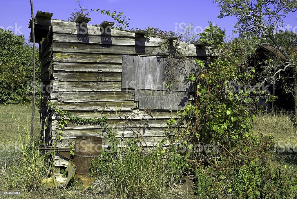 Old Weathered Shed and A Rusty Barrel royalty-free stock photo