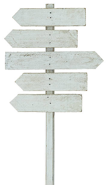 old weathered white wood arrow shaped signboards. - directional sign stock photos and pictures