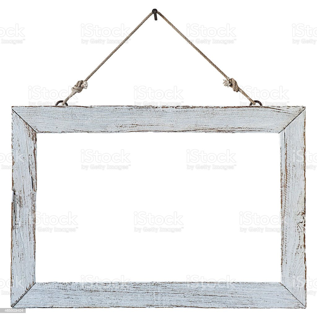 Old Weathered White Wood Frame Hanging By A Rusty Nail
