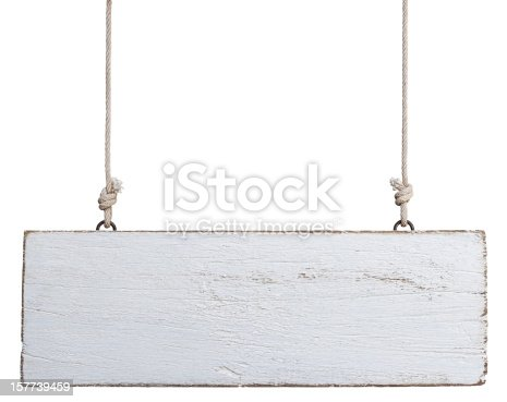 istock Old weathered white wood signboard. 157739459