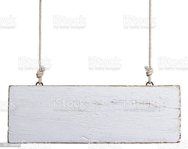 Old weathered white wood signboard, hanging by old rope, composite image, isolated on white.