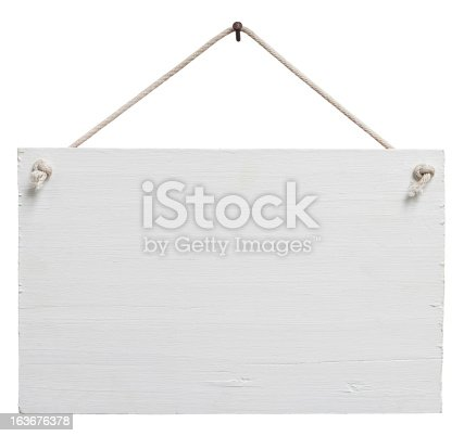 Old weathered white painted wood signboard, hanging by old rope from a nail, composite image, isolated on white, clipping path included.