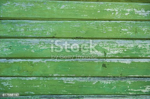 470927602 istock photo Old weathered wood planks painted in green. 617588192