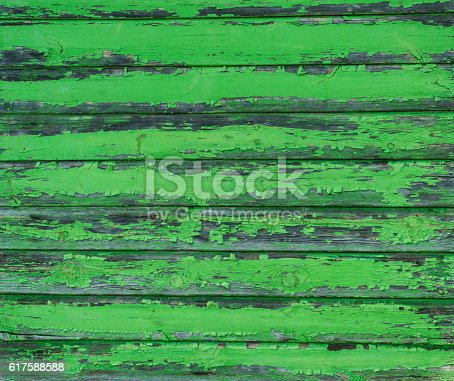 470927602 istock photo Old weathered wood planks painted in green 617588588