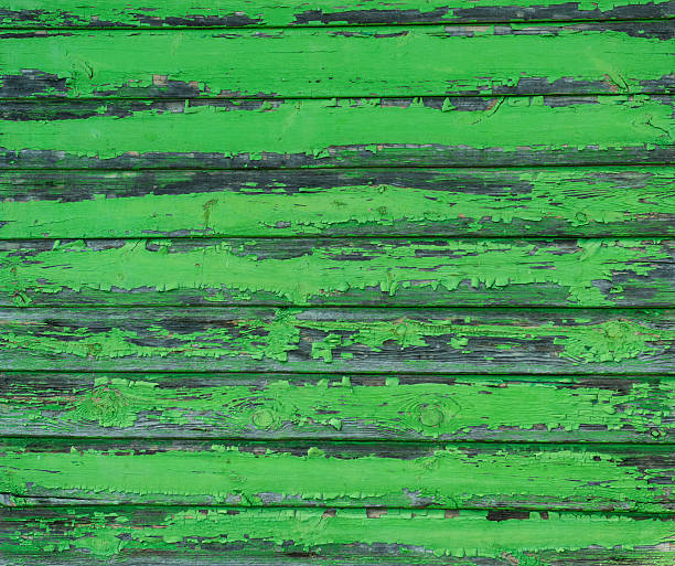 old weathered wood planks painted in green - treibholz wandkunst stock-fotos und bilder