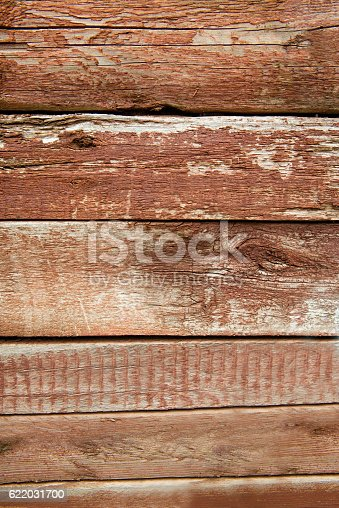 istock Old weathered wood planks painted in red 622031700