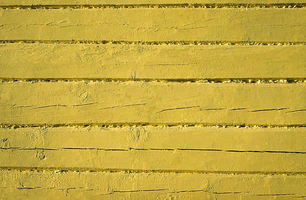 old weathered wood planks painted in yellow - treibholz wandkunst stock-fotos und bilder