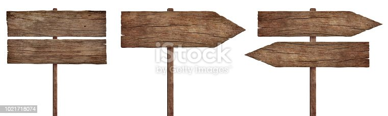 Three empty weathered roadsigns made of dark old wood. Pointing in different directions. Isolated on white background.