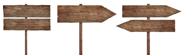 old weathered wood signs, arrows and signposts stock photo