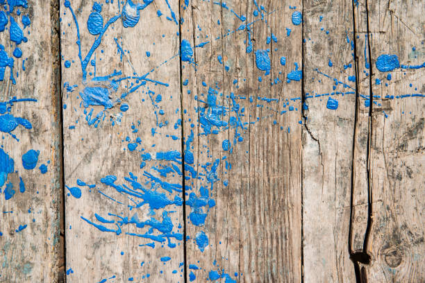 Old weathered wooden planks with blue stains of paint stock photo