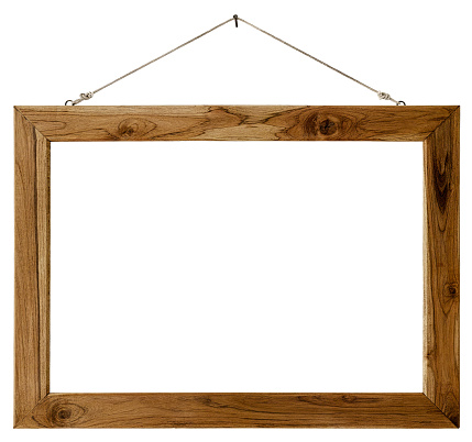 An old weathered wood picture frame hangs by old rope from a rusty nail, isolated on white, clipping path included. The frame is rustic with lots of grain detail.