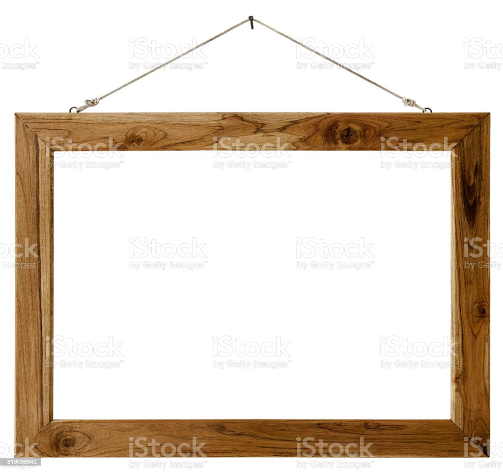 Old weathered worn natural wooden picture frame hanging by old rope from a rusty nail, isolated on white, clipping path included. stock photo