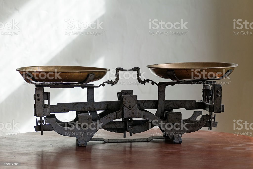 old weight balance scale made of metal stock photo