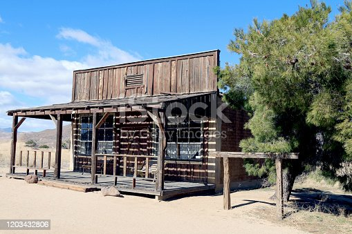 an old west abandoned ghost town shop building in the desert
