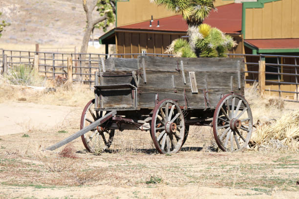 old west abandoned vintage wagon stock photo