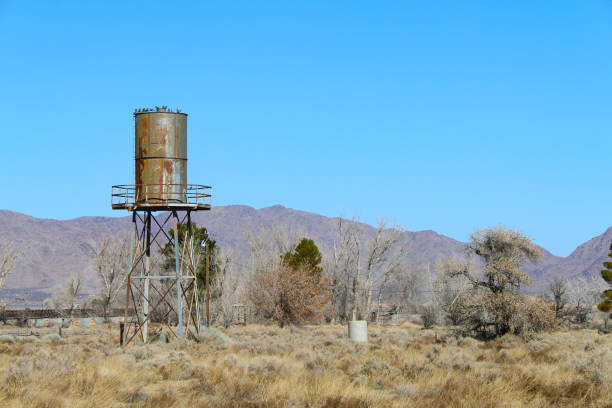 old west desert water tower stock photo