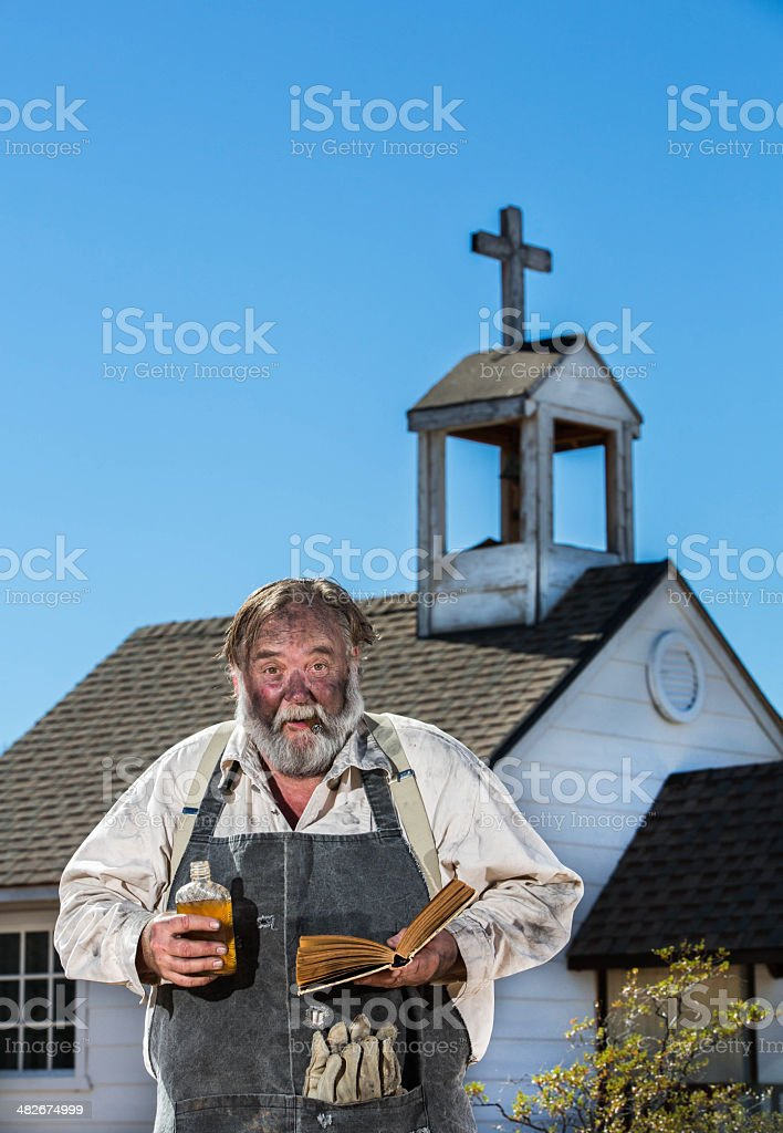 Old West Drunkard Holds Bible stock photo