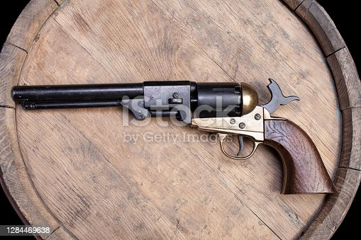 Old West Weapon - Percussion Army Revolver on wooden barrel