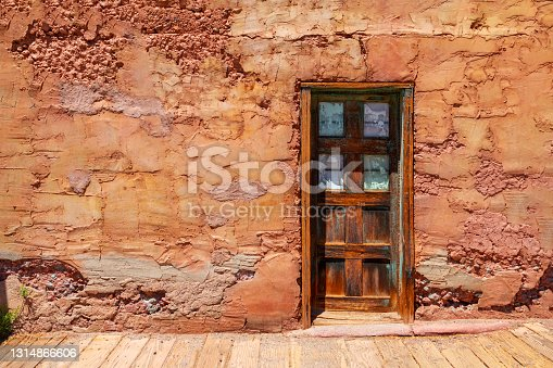 Old western rustic style door and wall with wooden floor