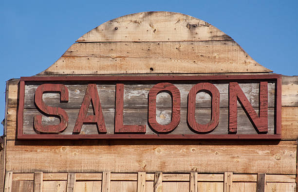 Old Western Saloon Sign Old western town saloon building sign in a ghost town of the wild west. A place for the town and travelers to meet and drink saloon stock pictures, royalty-free photos & images