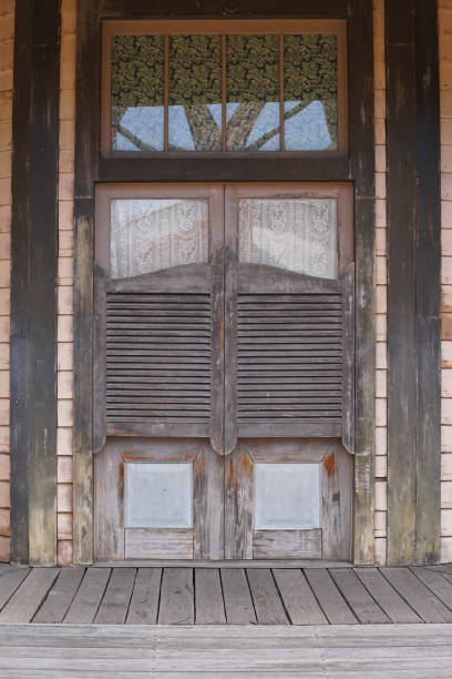 Old western swinging Saloon doors. Wild west cowboy style swinging door of an old Western building. Old western swinging Saloon doors. Wild west cowboy style swinging door of an old Western building. saloon stock pictures, royalty-free photos & images