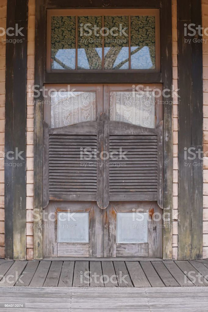 Old western swinging Saloon doors. Wild west cowboy style swinging door of an old Western & Royalty Free Saloon Doors Pictures Images and Stock Photos - iStock