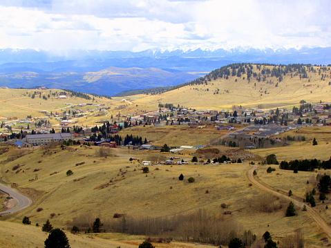 Sky view of an old western town, Cripple Creek Colorado.  This town is famous for gold mining and gambling.  The continental divide is in the background.