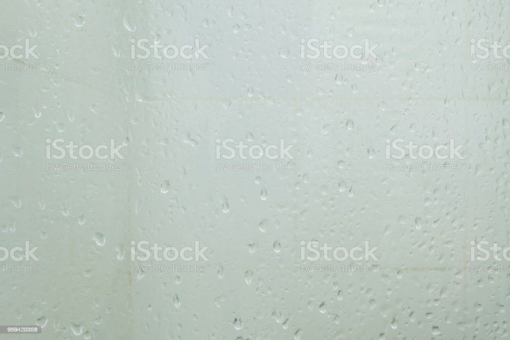 Old wet glass partition in bathroom background stock photo