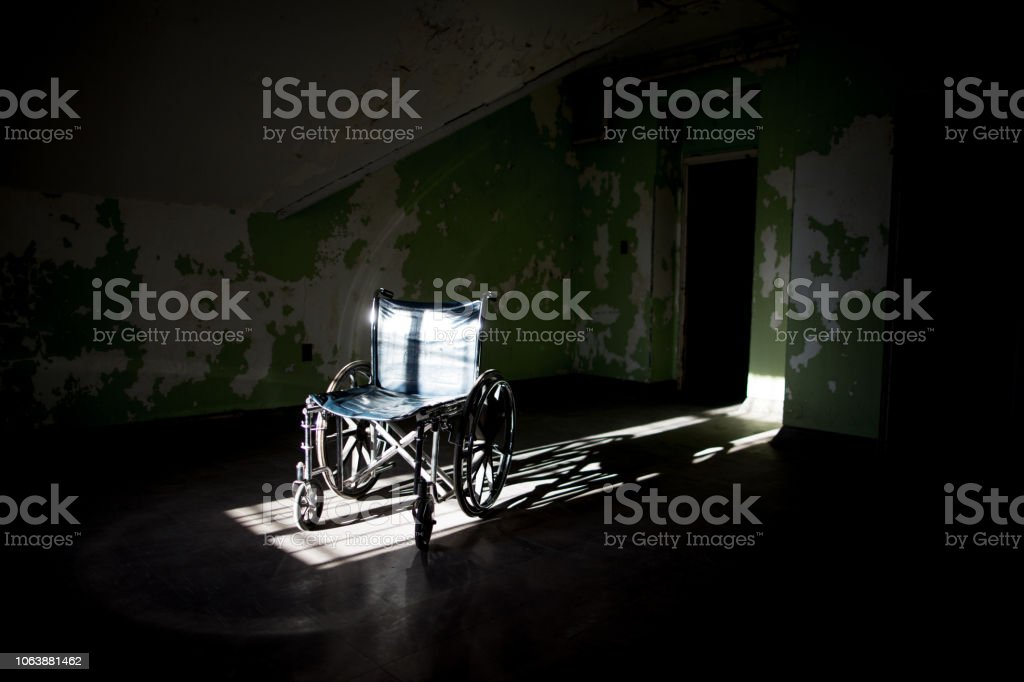 Old wheelchair in the sunlight stock photo
