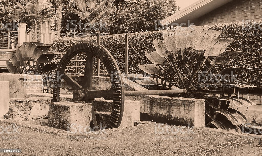 Old wheels of a watermill. Vintage style picture. stock photo