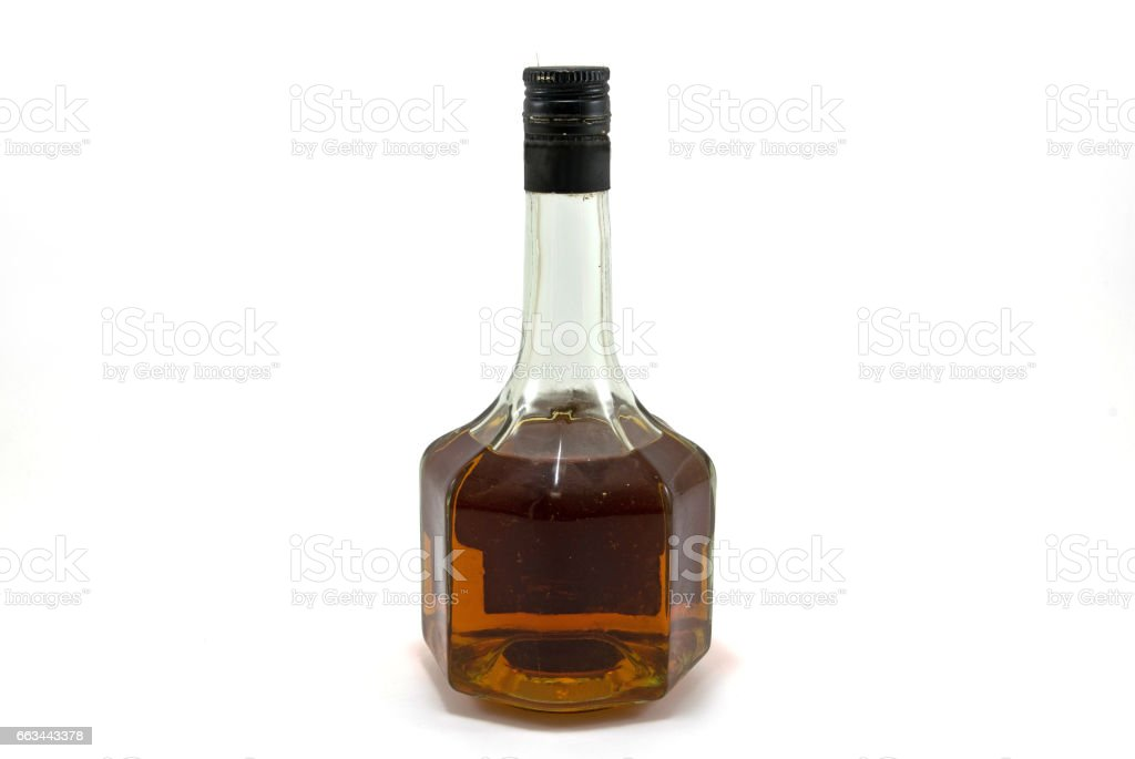 Old whiskey in beautiful bottle on white background. stock photo