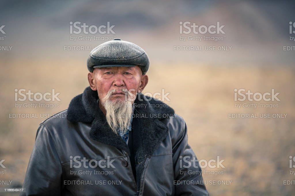 old-white-bearded-mongolian-man-in-a-lan