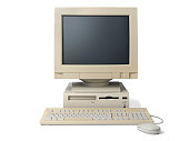 Old, white, desktop PC computer with a keyboard and mouse