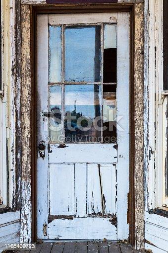 Old white door in Tombstone, Arizona, USA.