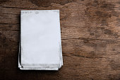 istock Old white paper on wooden floor. 1254464901