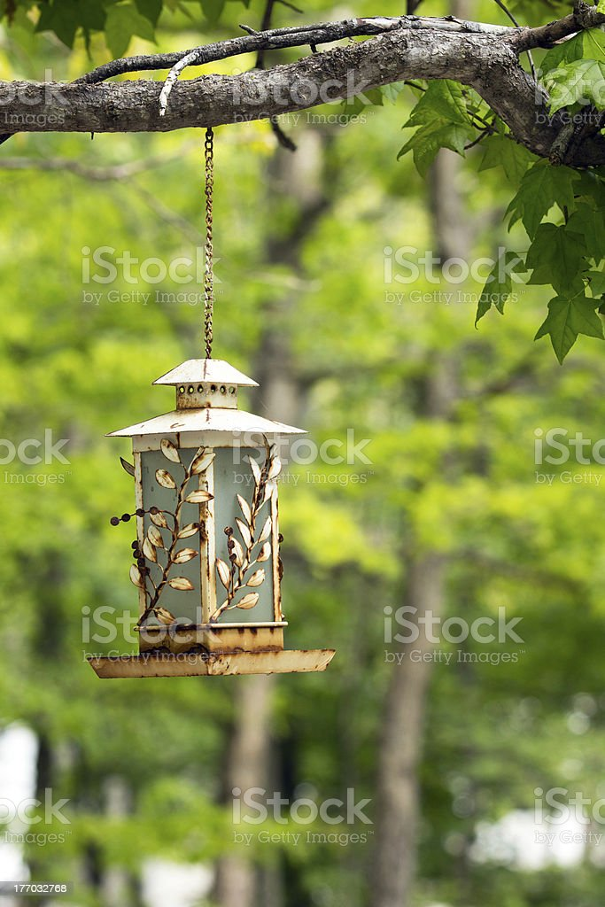 Old White Rusted Birdfeeder stock photo