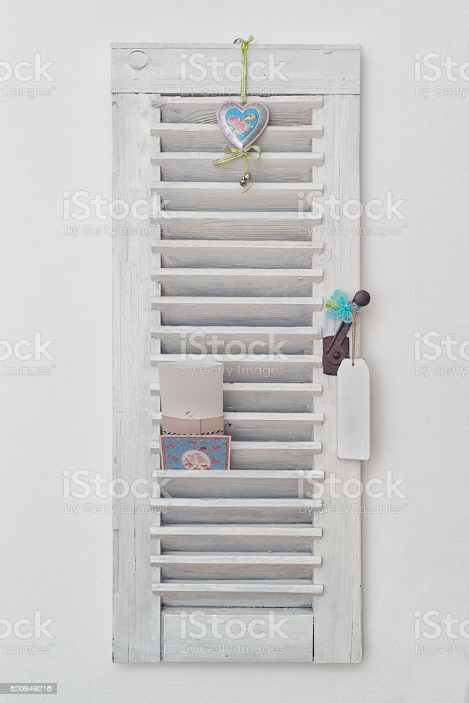 Old white shutters - decoration stock photo