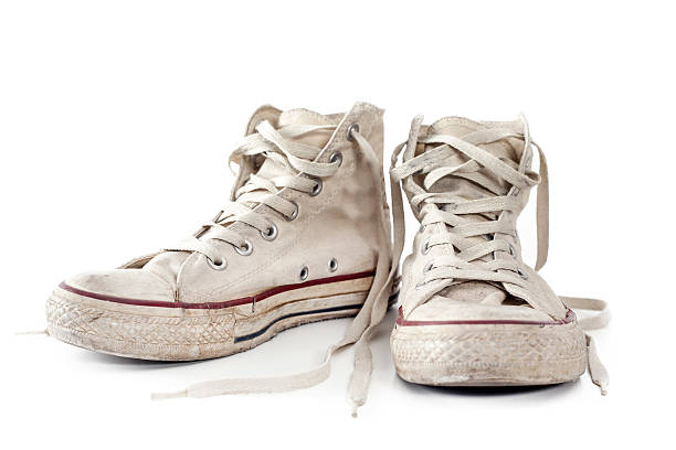 old white sneakers on white background - dirty shoes stock photos and pictures