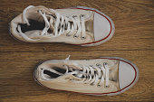 istock old white sneakers 1276570599