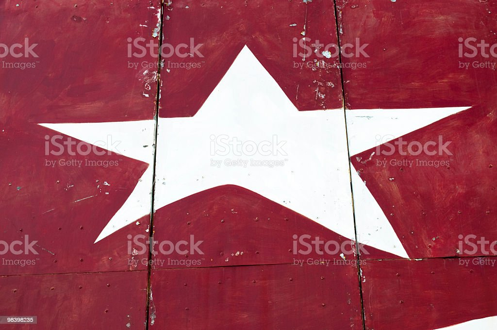 Old white star on red banner royalty-free stock photo