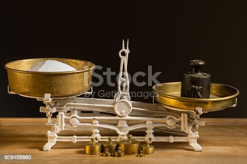 istock Old white vintage kitchen scale, brass with weights and sugar 928458860