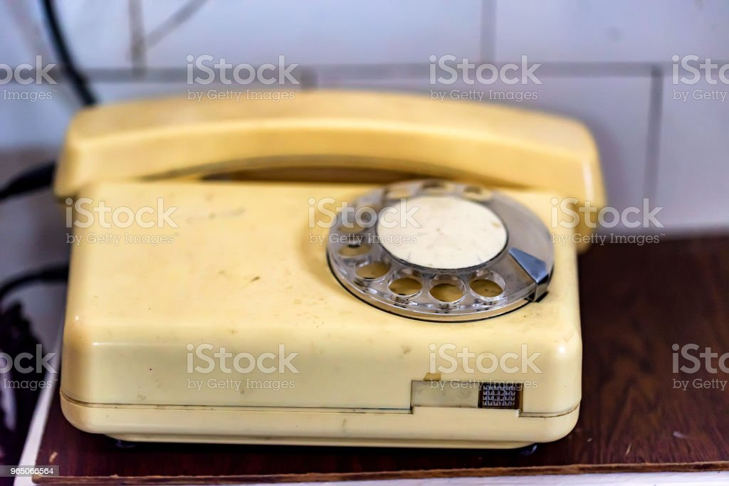 Old white vintage rotary phone close royalty-free stock photo