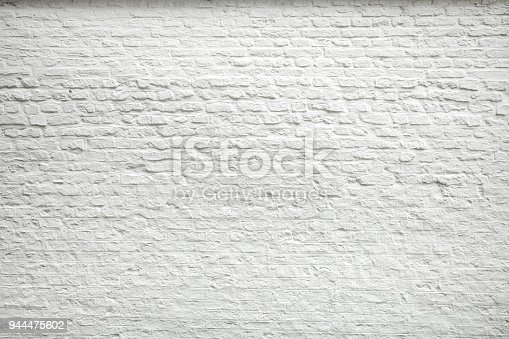 Texture of old dark white blocks, brick wall background.