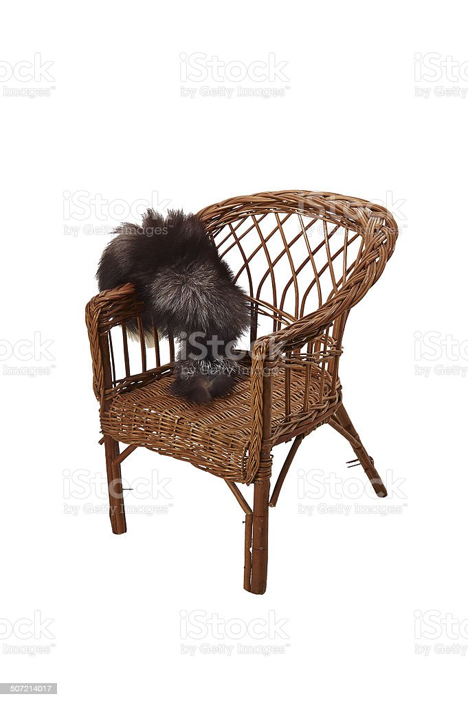 Old wicker chair mentioned about his youth stock photo
