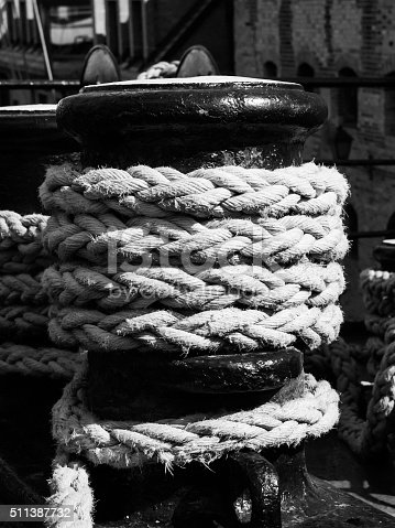 501889762istockphoto Old winch with ship rope 511387732